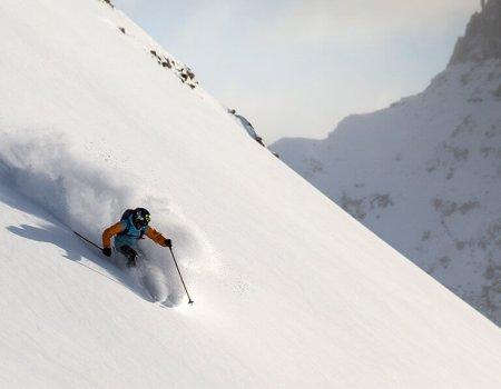 Skier on untouched powder