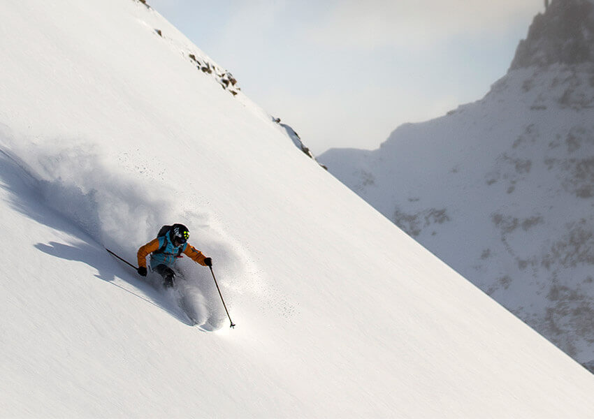 Skier on untouched powder
