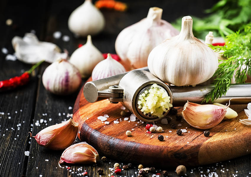 Essential Italian cooking tools - garlic press